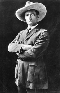 tom mix standing arms crossed